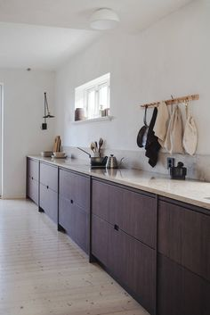 The couple behind Oslo kitchen design firm Ask og Eng show its application in their own home. Long Kitchen, Ikea Kitchen, Kitchen Decor, Kitchen Cost, Kitchen Drawers, Island Kitchen, Oslo, Home Remodel Costs, Kitchen Views