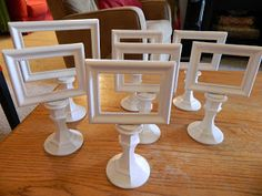 Polka-Dotty Place: DIY Table Signs using dollar store candlesticks and frames. Could be used with double frames for two sided signs. Use chalkboard style or more elegant labels. These also could identify items on buffet table or at a craft booth.