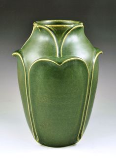 """JW Art Pottery - Grueby Style Leaf Vase - This vase is based on one of Grueby's rarest and most important forms. It is decorated with rows of leaves in very high relief, stands approximately 7 1/4"""" tall, and is glazed with a jade green matte glaze."""