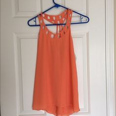 Size medium Orange top. Never worn! Tops Blouses