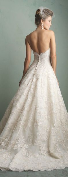 Strapless low back all lace gown with buttons to the floor. Beautiful back