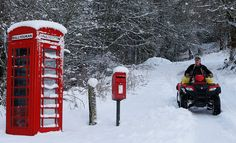 A farmer rides his quad bike on a snow-covered road in East Haugh, central Scotland