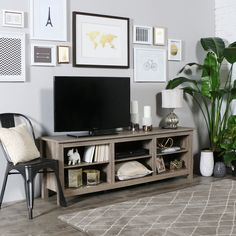 Features:  -Cannot be used with a TV floor mount.  -Back panel is divided into three separate pieces.  Product Type: -TV Stand.  Frame Material: -Wood.  Design: -Open shelving.  Hardware Finish: -Silv