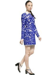 Image from http://cdnd.lystit.com/photos/2013/06/05/valentino-ivoryblue-nappa-lace-collar-jacquard-knit-dress-product-4-10453354-992544071_large_flex.jpeg.