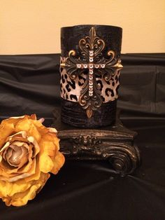 My one of a kind candle goes with any decor style. Custom made with a cross pin and crystals.