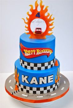 Hot Wheels Racing League: Hot Wheels Birthday Party Cakes - Cool cake with car jumping though flames. #hotwheels #cakes