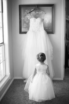 Classic Vineyard Wedding at Groom's Family Winery, Flower Girl Looking at Bride's Wedding Dress