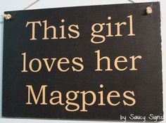 This Girl Magpies Football Sign  Welcome to Saucy Signs...  Located in rural Australia, Saucy Signs is a creative small business featuring hundreds of original handcrafted wooden signs for you to choose from.  Each sign is created individually and features a shabby look with attention to detail. Our signs measure approximately 12 x 9 inches or 30 x 21 cms. Larger signs can be ordered as custom signs.  The shabby and rustic finish of our signs is intentional, as is the brushed, scratchy &...