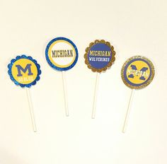 Check out this item in my Etsy shop https://www.etsy.com/listing/472682437/12-u-of-m-sports-cupcakecake-pop