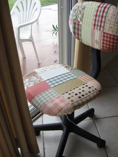 blogged  A book of upholstery samples, a sad , sagging computer chair, and a rainy day.
