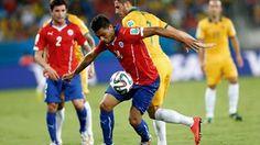 Gonzalo Jara of Chile controls the ball against Mathew Leckie of Australia