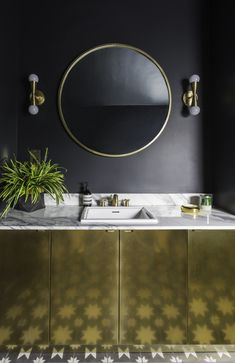 Looking for a contemporary bathroom decor look that channels the dark, moody interior trend? We love Jess from Gold Is A Neutral's bathroom transformation with her jet black walls, patterned bathroom floor tiles, marble shower and gold accessories through the room. Read our interview with Jess and see more pics inside her home