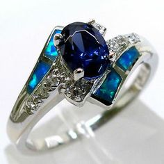 My engagement/ wedding ring. Tanzanite and blue opal!