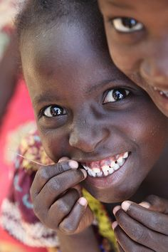 Smile. brightens my day. to see the smile on these children's faces...I can find no reason to feel down.