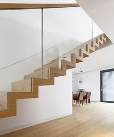 />Zigzag stair made of oak. Balustrade made of glass with wooden handrail. Stairs of the TECHNE line. Private residential project, designed by TRĄBCZYŃSKI. Glass Stairs, Glass Railing, Floating Stairs, Stairs In Living Room, House Stairs, Carpet Stairs, Staircase Railings, Staircase Design, Staircases