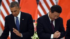 US President Barack Obama (L) returns to his seat as Chinese President Xi Jinping applauds after they drank a toast at a lunch banquet in the Great Hall of the People in Beijing on November 12, 2014. Obama began a one-day state visit after the closing of the Asia-Pacific Economic Cooperation summit. AFP PHOTO/Greg BAKER /POOL (Photo credit should read GREG BAKER/AFP/Getty Images)