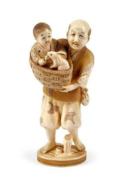 click the photo to enlarge A Japanese ivory okimono of a man, late Meiji, with colored robe holding a boy feeding a rabbit in a basket, seal mark. Height 12 cm