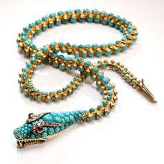 Collar Art Noveau (France) en oro 18 kt.y tuerquesas, formando una serpiente. . Cartier antique jewellery