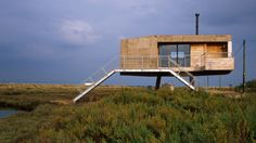 Lisa Shell designs artist's studio as a cork-clad cabin raised above a marsh