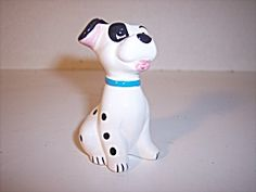 This porcelain puppy is white with black spots and one black eye! The copyright is DISNEY CHINA. He would be a nice addition to your Disney Collection.