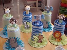 Baby Shower Centerpiece's-I made these for my daughter's Safari Baby Shower using receiving blankets, rattles and a little candle light