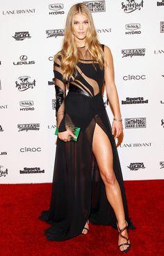 Nina Agdal in a sheer-top high-slit black dress