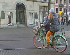 BIKE SHOPS IN THE HAGUE AREA  A mother cycles along the Buitenhof with baby on board. Find bike shops selling new and used bicycles, bike accessories and parts in The Hague, Delft, Wassenaar, Voorburg, Leidschendam and Rijswijk areas of Zuid-Holland (Netherlands) here... https://www.angloinfo.com/south-holland/directory/south-holland-bicycle-shops-service-the-hague-area-811