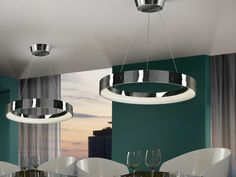 Large LED pendant. Made of metal, chrome finish. Hidden lighting with LED stripe. Adjustable in height.