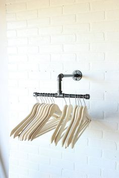 Industrial clothing rack with two 6 inch bars split to either side for a total of 12 inches of space for any size hangers. All mounting hardware