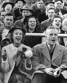 Alfred Eisenstaedt—Time & Life   Coed Merrilyn Olson and date Brooks Conrad watching Wisconsin-Marquette football game_1939