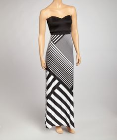 A maxi dress for the modern maven. Black and white stripes angle down the front of the long, fluid skirt, while a sweetheart neckline tops off the look with a classic, feminine touch. Size note: This item runs small. The vendor recommends ordering one size up. Measurements (size M): 49'' long from center bac...