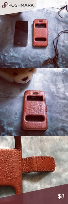 📱IPhone 4📱Leather case Used it twice. There's a small crack at the bottom corner(refer last picture). Conveniently inclined back stand to watch movies. Iphone  Accessories