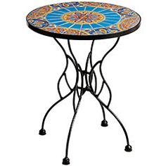This outdoor table features a kaleidoscope of color atop a sturdy iron base. Each tile has been handcrafted out of clay, screen-printed, then individually hand-painted, making each table a unique and festive work of art. But one that easily fits on patios, porches, balconies--anywhere you want some color.