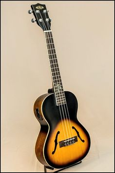 Fell on my face in love with this ukulele today, soon you shall be mine! (Kala JTE/2TS Archtop Sunburst Electric Tenor)