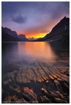 """Thunderstorm at sunset from the banks of Saint Mary Lake, Glacier National Park, Montana."" Photo by Joseph Rossbach."