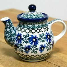 Cute little teapot with a cornflower pattern. Polish pottery :)