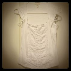 Adorable White Stitched Sleeveless Tank/ Shirt Gives a great waist! Cute bows and stitching details. Great condition - only worn a couple times. Tops Tank Tops