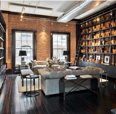 Black wood flooring and those shelves! The brick too. Mostly this entire room.