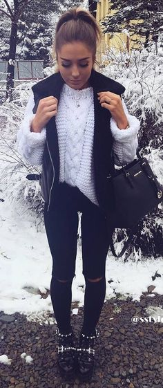 what to wear with a leather vest : white sweater + bag + skinnies + boots