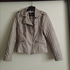 "Guess grayish taupe faux leather quilted jacket Super flattering and sexy Guess grayish taupe faux leather fitted quilted jacket. Size L, very light in weight. NWOT! Cannot negotiate much on this item as I'm already taking a huge loss. Purchased at Notdstroms. 21.5"" arm pit to arm pit. ***lowest price marked*** Guess Jackets & Coats"