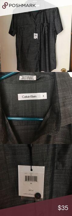 Men's Calvin Klein button down Men's medium Calvin Klein shorts sleeve button down. Striated gray with a slight sheen Calvin Klein Shirts Casual Button Down Shirts
