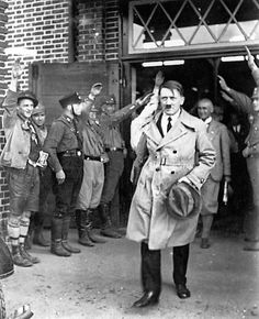 Hitler after delivering a 3 hour speech in February, 1931. Frick trails behind. Great photo!! (via putschgirl)