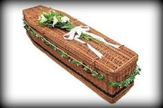 Wicker & Willow Coffins | Light & Brown Willow Eco-Coffins. Ivy / foliage / possibly some small flowers around the coffin?