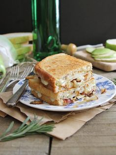 Pear and Bacon Grilled Cheese with Brie and Caramelized Onions- Sweet, salty and cheesy deliciousness between two slices of sourdough bread. Recipe calls for infusing melted butter with rosemary to grill the sandwich in is a unique way to add a bit of savory herb flavor.