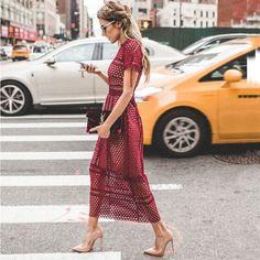YSL clutch, maroon maxi, and nude stilettos street style