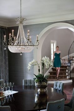Like the button down chairs, arch entry and wrought iron stair balustrade, lily in silver pot is cool too