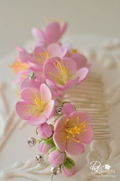 Recently I had a potential client on Etsy contact me about my cherry blossom hair comb that I had made last year and she was hoping I could. Dyi Flowers, Sugar Flowers, Handmade Flowers, Felt Flowers, Paper Flowers, Fondant Flowers, Polymer Clay Flowers, Polymer Clay Crafts, Fondant Flower Tutorial