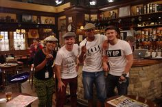 Capital Radio's Hirsty and the gang showing off eeebahgum in the Woolpack at Emmerdale on Yorkshire Day