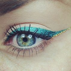 teal eyeliner with a splash of gold