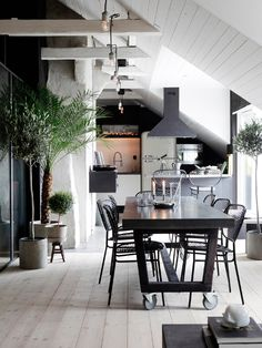 Oh my I love this kitchen dining look. Greys, industrial, french, indoor olive tree and concrete pots.